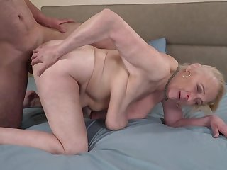A big hairy dude is fucking a horny ancient granny atop burnish apply bed