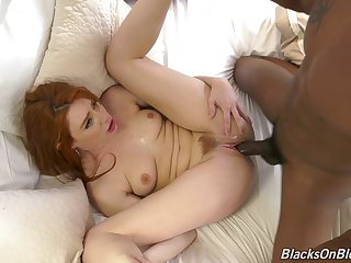 The heavy Stygian dick suits this ginger's pussy just fine