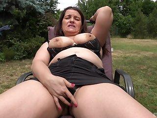 Faggot shows off in the back yard, masturbating like a slut