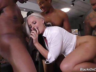 Ravishing blonde lady is enjoying while having group mating with many insidious guys from her neighborhood