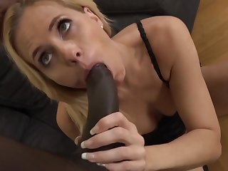 Mature blonde unspecific is sucking a big, black dick and getting it inside her pussy