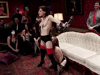 Alice March and Audrey Holiday are among the subs at a BDSM party