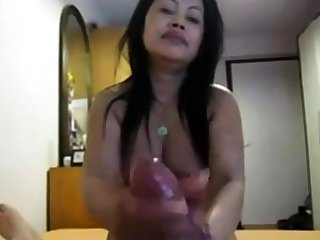 Amateur Asian gives on the mark pov hj to fat cock